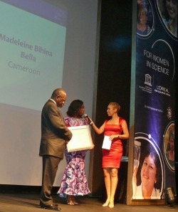 Madeleine receiving her award from Ursula